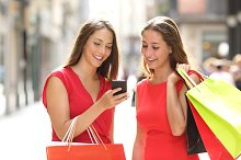 Two fashion shoppers shopping with a smart phone.jpg