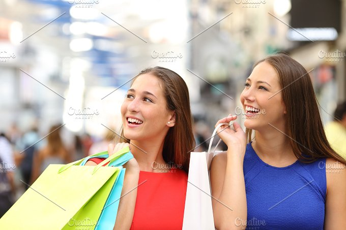 Two friends shopping in a mall.jpg - Beauty & Fashion
