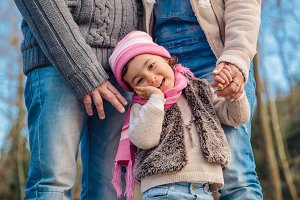 Little girl enjoying with parents