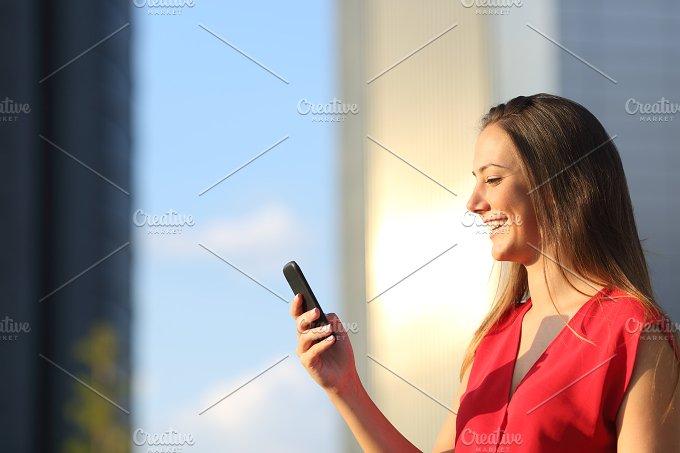 Business woman using a smart phone.jpg - Technology