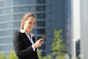 Executive working with a mobile phone.jpg