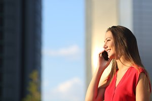 Business woman talking on the mobile phone.jpg
