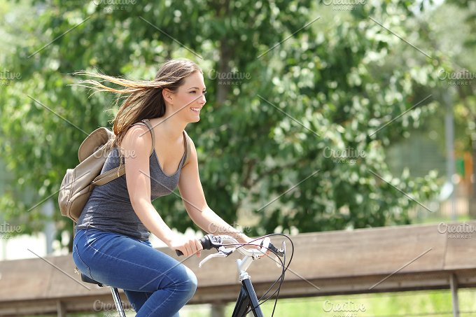 Cyclist woman riding bicycle in a park.jpg - Transportation