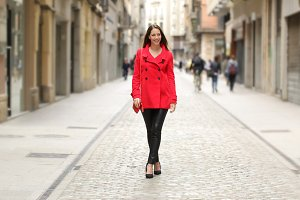 Fashion woman in red walking on a city street.jpg