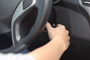 Driver hand starting the car with the key.jpg