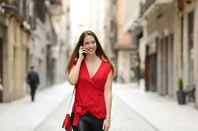 Fashion woman walking and talking on the mobile phone.jpg