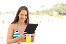 Girl reading a tablet or ebook on summer holidays.jpg