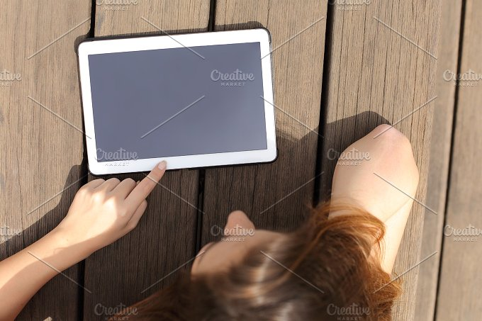 Girl using and showing a blank tablet screen.jpg - Technology