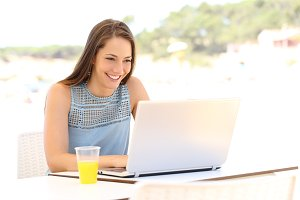 Girl using a laptop on summer vacation.jpg