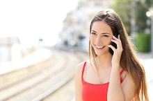 Lady talking on the mobile phone in a train station.jpg