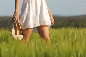 Relaxed woman legs walking in a field in summer.jpg