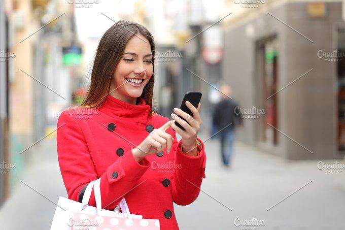 Shopper buying online on the smart phone.jpg - Technology