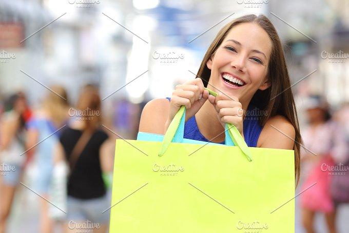 Shopper girl buying and holding a shopping bag.jpg - Beauty & Fashion