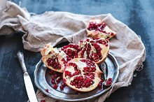 Pomegranate on a rustic metal plate