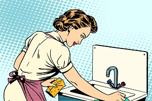 woman cleans kitchen sink