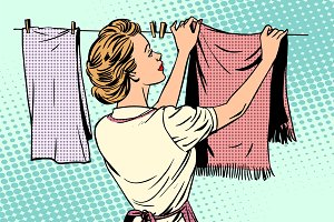 woman hangs clothes after washing