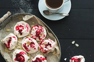 Raspberry meringues & cup of coffee