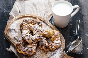Cinnamon buns on a wooden board