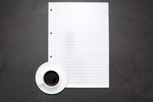 Coffee and sheet of paper