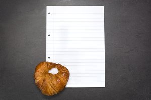 Croissant and sheet of paper