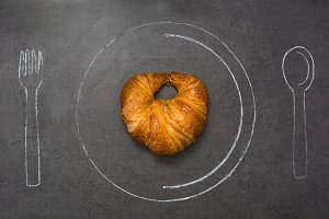 Croissant on slate table