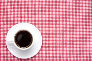 Coffee on checkered tablecloth