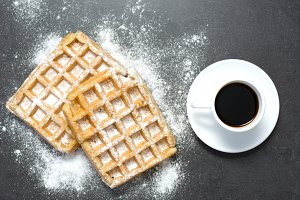 Waffles and coffee on slate table