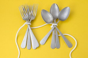 Spoons and forks tied with rope