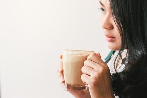 Woman drinking hot latte coffee