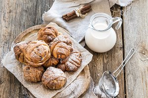 Cinnamon buns on a rustic board