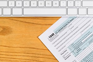 Keyboard and Tax Form