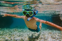 Child snorkelling. by  in Holidays