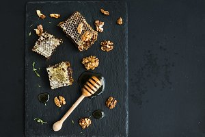 Honeycomb, walnuts and honey dipper