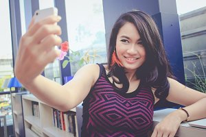 woman taking selfie in the office