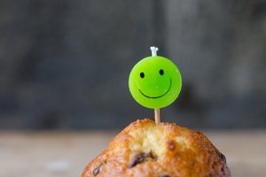 Chocolate chip cupcake and smiley ca