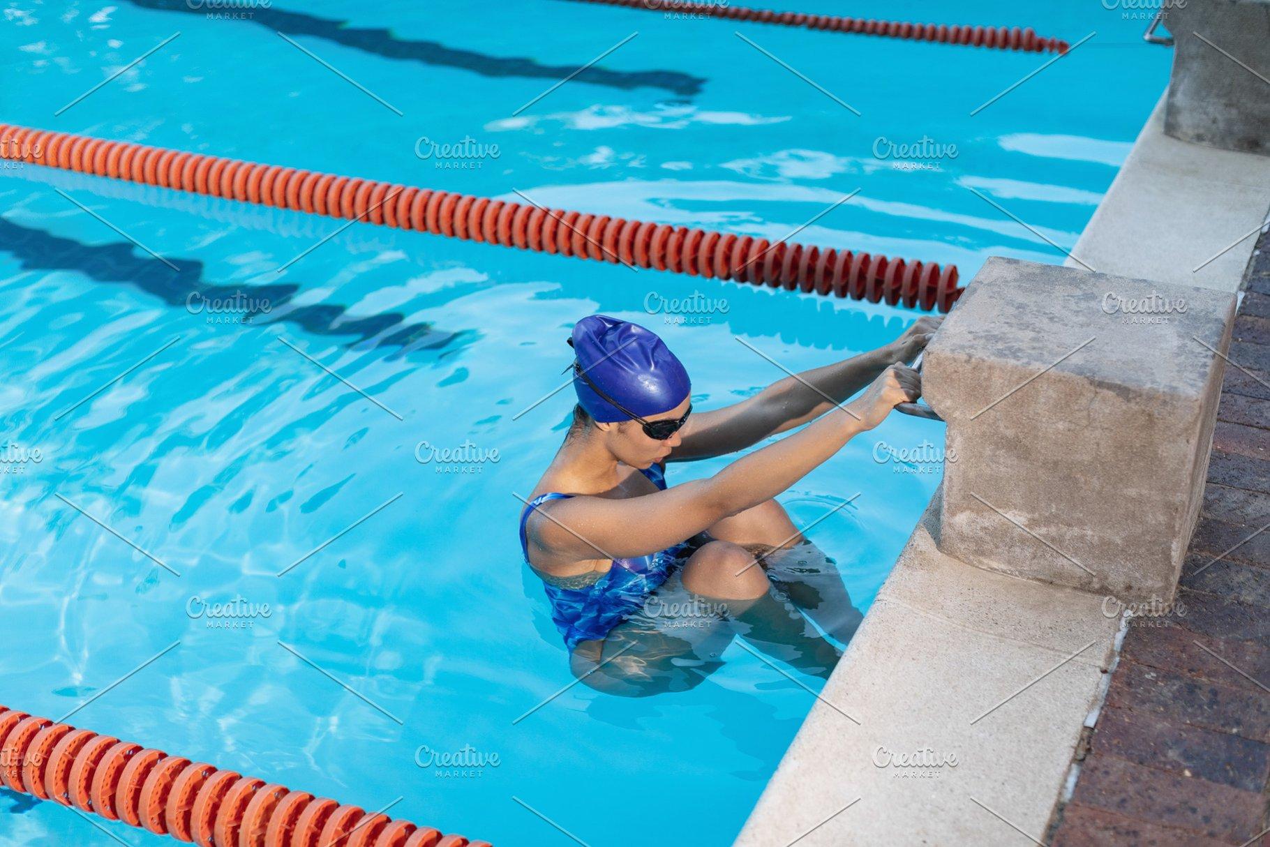 Female swimmer on the starting block