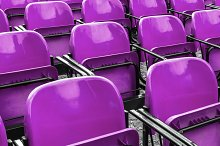 Empty plastic violet chairs by  in Abstract