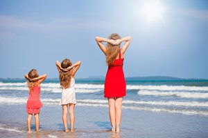Mother and daughters on the beach