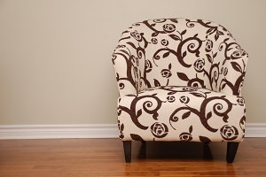 Fancy chair on a cream colored wall