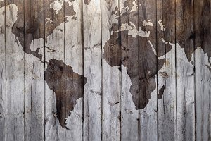 World map drawn on canvas wood