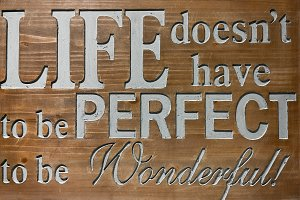 Life Quote on wooden sign background