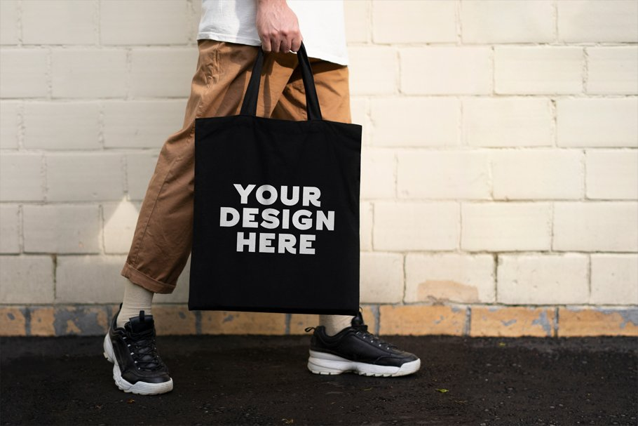 749b7d14 Man with black tote bag ~ Product Mockups ~ Creative Market