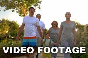 Family walk outdoor on summer resort