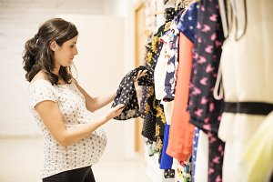Pregnant woman in clothes store.