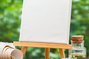 Canvas on easel and artist tools