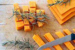 Chopping pumpkin slices