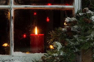 Christmas Window with Glowing Candle