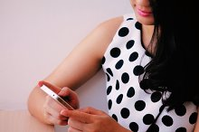 A beautiful woman is using iphone