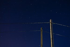 Electric poles and starry sky