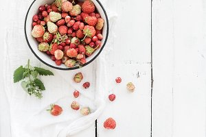 Wild strawberries in rustic bowl